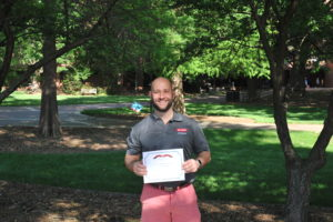 Mike Vysocka holding his Web Accessibility Challenge Winner Certificate