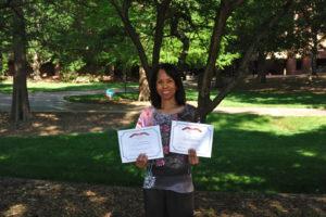 Deborah Harvey holding her Web Accessibility Challenge Winner Certificate