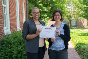 Elizabeth Snively and Jacqueline Perry holding their Web Accessibility Challenge Winner Certificate